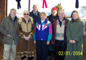 2004.25 - Denny & Marg May, RCMP Pilot Jerry Klammer & Nick Lees in back, Gloria & Bob Horner & Teresa Williams - Peace River, Jan 02 2004